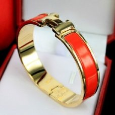 replica Hermes narrow clic H yellow gold bracelet with orange enamel